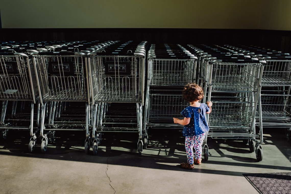 Child playing with grocery shopping carts