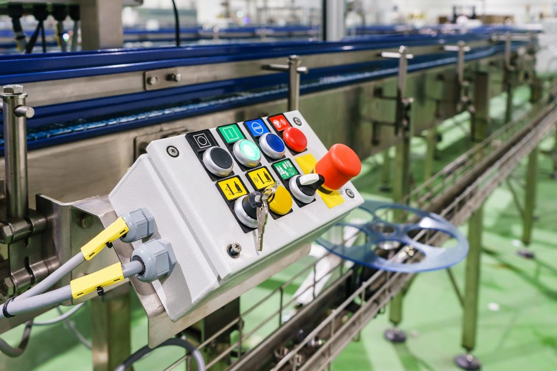 Emergency Stop installed at line conveyor for machine factory, START - STOP Button for industrial machine, Industrial and factory concept, Engineering concept